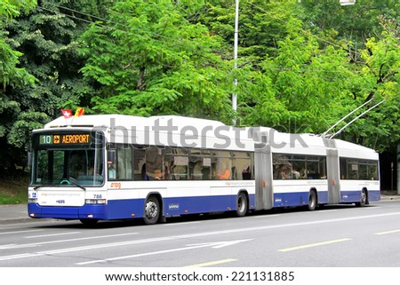GENEVA, SWITZERLAND - AUGUST 4, 2014: White and blue 24.7m long double-articulated trolleybus Hess LighTram 3 at the city street. - stock photo