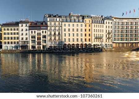 GENEVA, SWITZERLAND - JULY 20, 2010: Banks and financial companies occupy real estate next to Lake Geneva July 20, 2010 in Geneva, Switzerland. Geneva is one of the world's leading financial hubs. - stock photo
