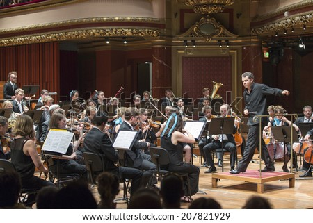 GENEVA, SWITZERLAND - JUNE 22, 2014: Antoine Marguier conducts the United Nations Orchestra at the Victoria Hall during a free concert as part of the city's festival of music. - stock photo