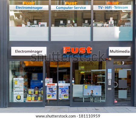 GENEVA, SWITZERLAND � MARCH 2, 2014: A Fust retail outlet. Fust is the largest chain in Switzerland of specialty shops in appliances and consumer electronics and has about 150 outlets. - stock photo