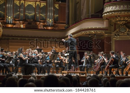 GENEVA, SWITZERLAND -Â?Â? MARCH 21, 2014: Antoine Marguier conducts the UN Orchestra at the Spring Concert 2014 in the  Victoria Hall. - stock photo