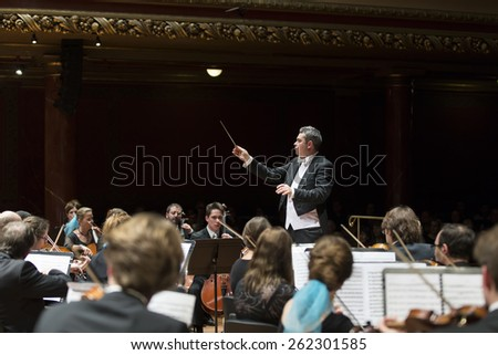 GENEVA, SWITZERLAND � MARCH 1, 2015: Antoine Marguier conducts the United Nations Orchestra at a concert at the Victoria Hall commemorating 200 years of Geneva in the Swiss Confederation. - stock photo