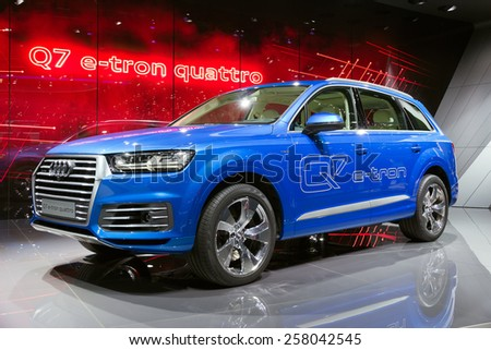 GENEVA, SWITZERLAND - MARCH 3, 2015: Audi Q7 E-Tron Quattro diesel electric plug-in debut at the 85th International Geneva Motor Show in Palexpo. - stock photo