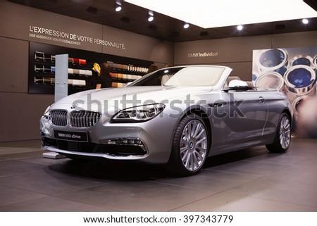 GENEVA, SWITZERLAND - MARCH 1: Geneva Motor Show on March 1, 2016 in Geneva, BMW 650i xDrive, front-side view - stock photo