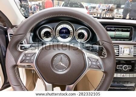 GENEVA, SWITZERLAND - MARCH 4, 2015: Mercedes E220 BlueTEC dashboard at the 85th International Geneva Motor Show in Palexpo. - stock photo