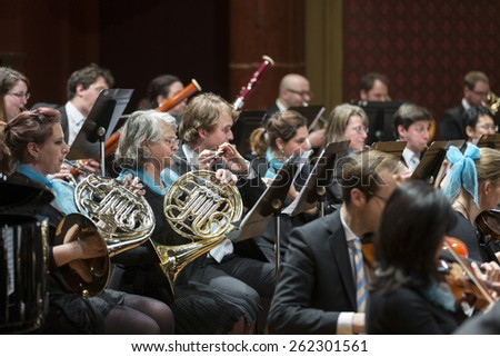 GENEVA, SWITZERLAND MARCH 1, 2015: Musicians playing in the United Nations Orchestra at a concert at the Victoria Hall commemorating 200 years of Geneva in the Swiss Confederation. - stock photo