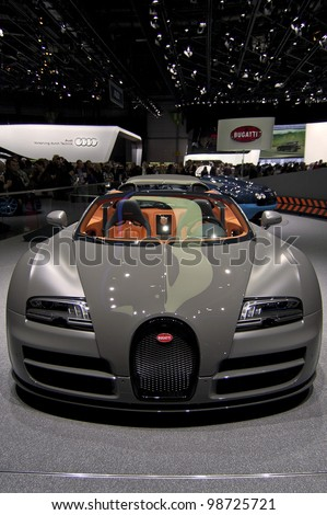 GENEVA SWITZERLAND - MARCH 12: The Bugatti Stand displaying a full frontal view of the Veyron convertible in MATT Gunmetal grey, at the Geneva Motorshow on March 12th, 2012 in Geneva, Switzerland. - stock photo