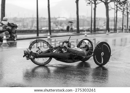GENEVA, SWITZERLAND - MAY 3, 2015: Handcycle athlete Jean Marc Berset turns for the final kilometer to win the semi-marathon handbike race as part of the Harmony Geneva marathon for UNICEF.  - stock photo