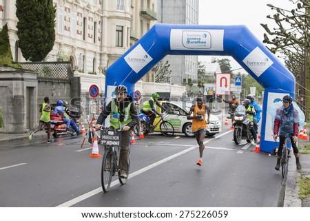 GENEVA, SWITZERLAND - MAY 3, 2015: Kenyan Peter Kiplagat,  winner in a time of 2h 11m 18 sec, running with just 1 Km to go in the Harmony Geneva marathon for UNICEF.  - stock photo