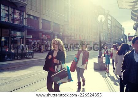 GENEVA, SWITZERLAND - MAY 10, 2013: People walking on Rue du Marche, main shopping street in the center of Geneva. Toned image, instagram effect - stock photo
