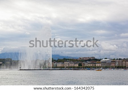 GENEVA,SWITZERLAND - SEPT.10:fountain Jet d?Eau rises over waterfront of Lake Geneva, Switzerland, September 10, 2013. fountain in Geneva important sight of city and one of biggest fountains in world.