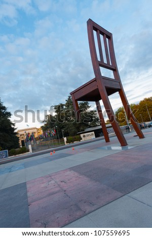 GENEVA, SWITZERLAND - SEPTEMBER 29: The United Nations European headquarters entrance and broken chair in Geneva, Switzerland on September 29, 2010. The UN deals with world issues daily. - stock photo