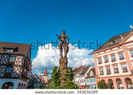 GENGENBACH, GERMANY - SEPTEMBER 6, 2014: The Stony Knight on the Roehr Fountain and the town hall of Gengenbach, Black Forest, Baden-Wuerttemberg, Germany, Europe - stock photo