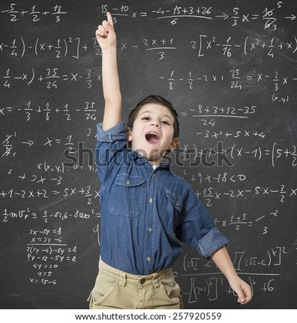 Genius child solves a mathematical calculation difficult - stock photo