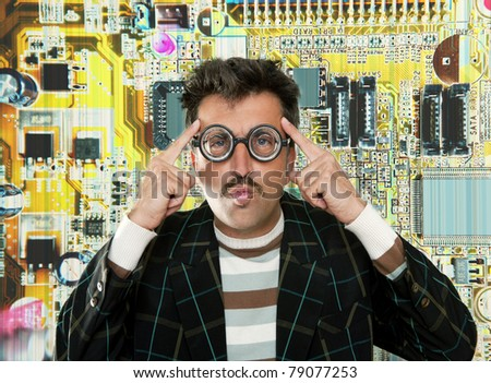 Genius nerd electronic engineer tech man thinking gesture electronics motherboard chip background [Photo Illustration] - stock photo