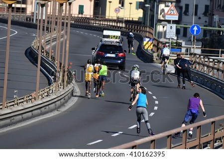 GENOA, ITALY - APRIL, 24 2016 - Annual non competitive marathon along town streets and causeway