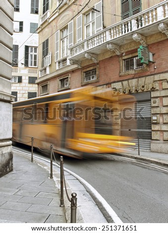 GENOA, ITALY - APRIL 06, 2013: Genoa is a historical port of city in northern Italy.Narrow street of Genoa, Italy on April 06, 2013. - stock photo