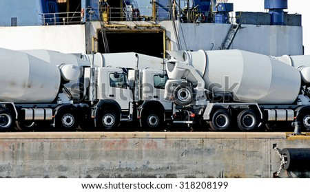 GENOA, ITALY - AUGUST 20, 2015: Maritime personnel and equipment to work on the docks of the commercial port of Genoa. Goods and cargo ships.