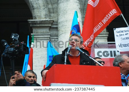 "GENOA, ITALY-DECEMBER 12 - national general strike against the government Renzi and the ""jobs act"" on stage in Genoa national secretary metalworkers Maurizio Landini- Genoa, Italy on dec 12 2014"