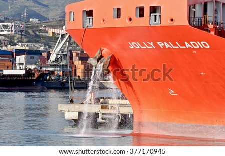GENOA, ITALY - FEBRUARY 5, 2016: The ship JOLLY PALLADIO. The vessel has a deadweight of 44574 tonnes and was built in 2015. In the photo the ship moored at the quay.