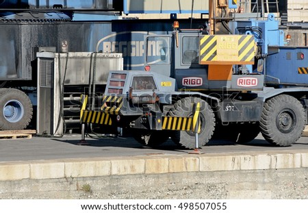 GENOA, ITALY - FEBRUARY 5, 2016: working vehicle on the commercial quay of port. Mobile crane with diesel engine.