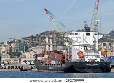 GENOA, ITALY - JUNE 25, 2015: A cargo ship Marfret Durande in the commercial seaport in Genoa