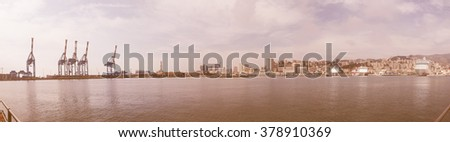 GENOA, ITALY - MARCH 16, 2014: Wide panoramic view of the city of Genoa skyline from the sea vintage
