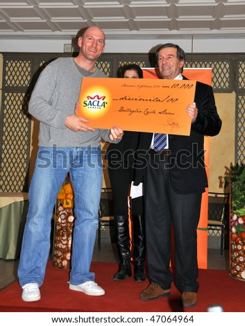 GENOVA, ITALY - FEBRUARY 16: Lawrence Dallaglio accepts a cheque for his foundation from the president of SACLA Italy:  February 16, 2010 in Genova, Italy.