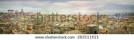 Genova, ligurian town skyline, daylight with rays on horizon - stock photo