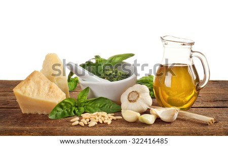 Genovese pesto ingredients on wooden table