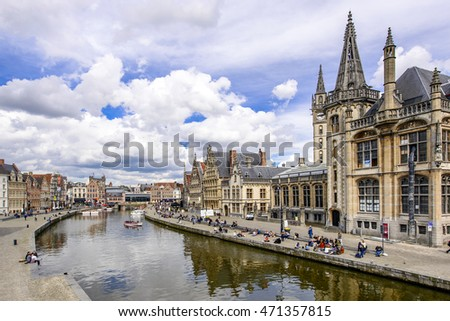 GENT - APRIL 12: Unidentified tourists visit historical center of Gent with gabled houses along canal on April 12, 2016 in Gent, Belgium