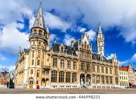 Gent, Belgium. Medieval buildings and the old Post Office as seen from St Michael's bridge at evening, Ghent, Flanders. - stock photo