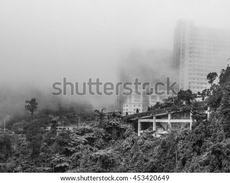 GENTING HIGHLANDS, MALAYSIA -  January 3; 2016:  Black and white view of the misty city skyline