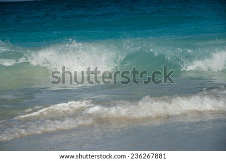 Gentle and clear waves of the ocean - stock photo