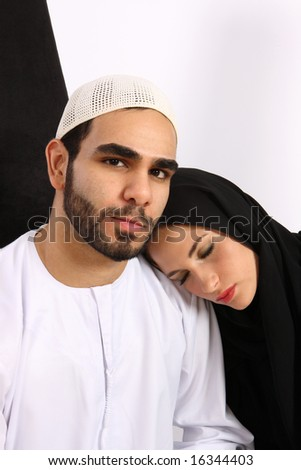 Gentle Arab Husband With His Beautiful Wife Sleeping On His Shoulder - stock photo