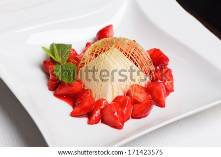 gentle cheesecake with strawberries and strawberry syrup - stock photo