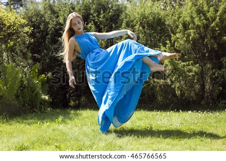 gentle girl flying in the blue dress
