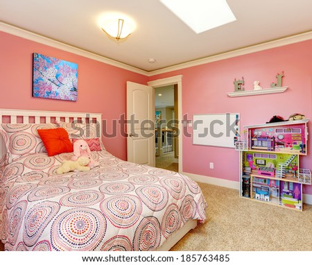 Gentle girls bedroom with white bed and pink walls. View of board on the wall and toy house - stock photo
