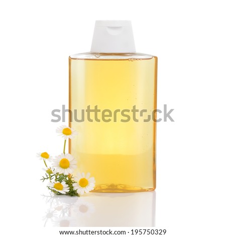 Gentle hair shampoo with chamomille and camomile flowers isolated on white background. Highlights and illuminates blonde hair. - stock photo
