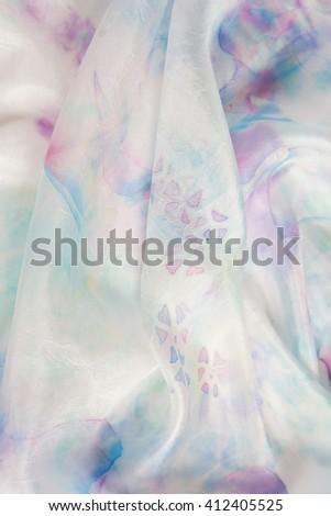 Gentle hand painted silk pastel colored. Handmade batik. Shallow focus - stock photo
