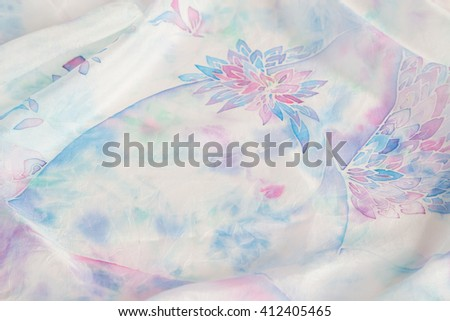 Gentle hand painted silk with woman silhouette print on pastel colored background. Handmade batik. Shallow focus - stock photo
