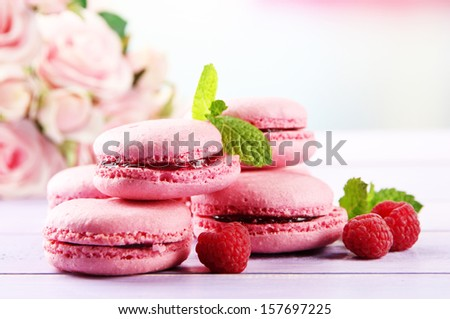 Gentle macaroons on table on light background - stock photo