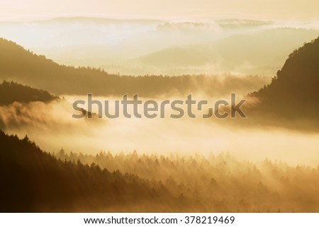 Gentle misty landscape in hilly country. Retro style filter. Orange toning effect. - stock photo