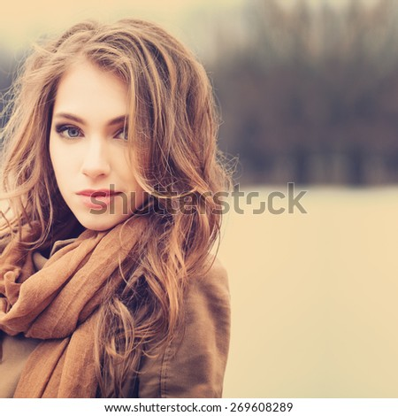 Gentle portrait of a beautiful redhead girl - stock photo