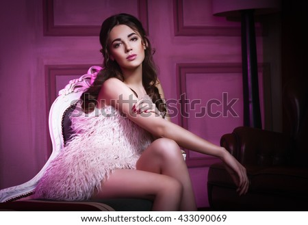gentle portrait of a beautiful young sexy girl beauty portrait for  advertising like painting oil, soft and cute girl sitting on a vintage  chair naked in a fur coat  the girl a nice make-up - stock photo