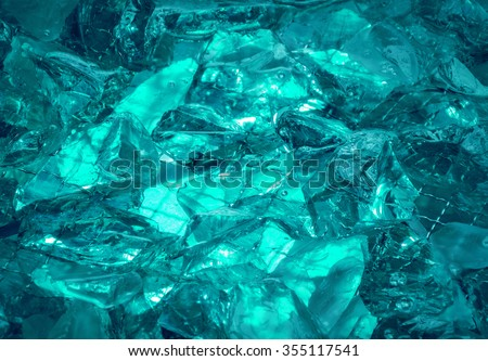Gentle teal fond of sparkling water-washed grained rock with jagged edges, mysteriously lit cerulean celeste cyan glow. Closeup view with space for text - stock photo
