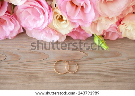 Gentle Vintage Wedding  Background with gold Rings and beautiful flowers - stock photo