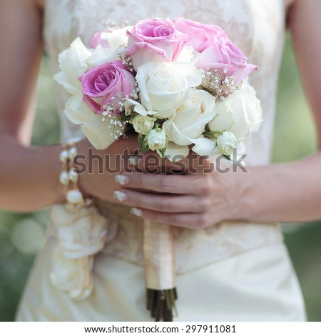 Gentle wedding bouquet of flowers in hands elegant bride - stock photo
