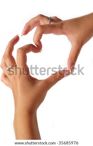 Gentle woman hands in the shape of a heart - stock photo