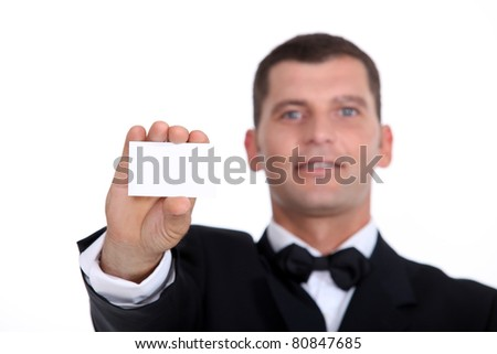 Gentleman showing business card - stock photo